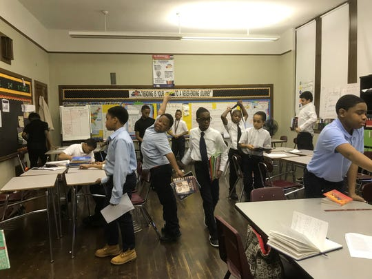 Students at Paul Robeson Malcolm X Academy get ready to switch classes on a recent day.