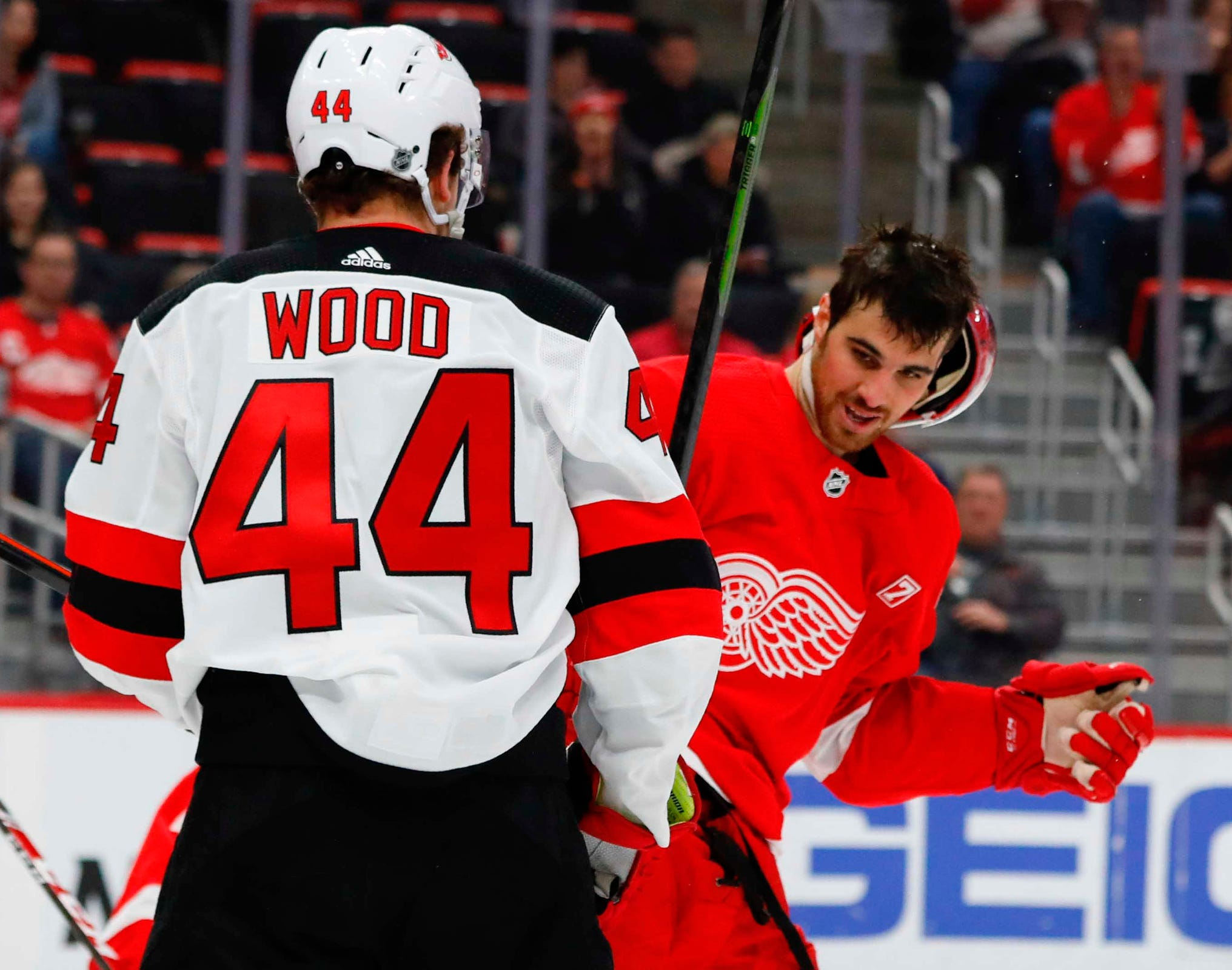 Devils left wing Miles Wood shoves Red Wings defenseman Jake Chelios in the first period on Friday, March 29, 2019, at Little Caesars Arena.