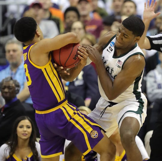 Michigan State forward Aaron Henry ties up LSU guard Tremont  Waters during the second half of MSU's 80-63 win over LSU in the NCAA tournament on Friday, March 29, 2019, in Washington.