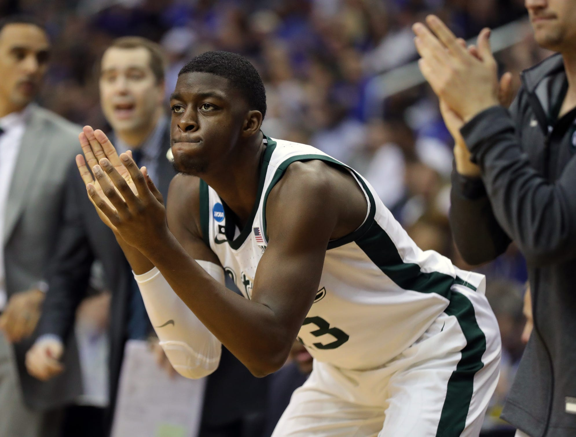 Gabe Brown supports the team during the second half of MSU's win over LSU in the Sweet 16.