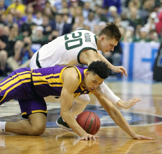 Michigan State guard Matt McQuaid goes for lose ball against LSU guard Skylar Mays during the first half of NCAA tournament action on Friday, March 29, 2019 at Capital One Arena in Washington, DC.