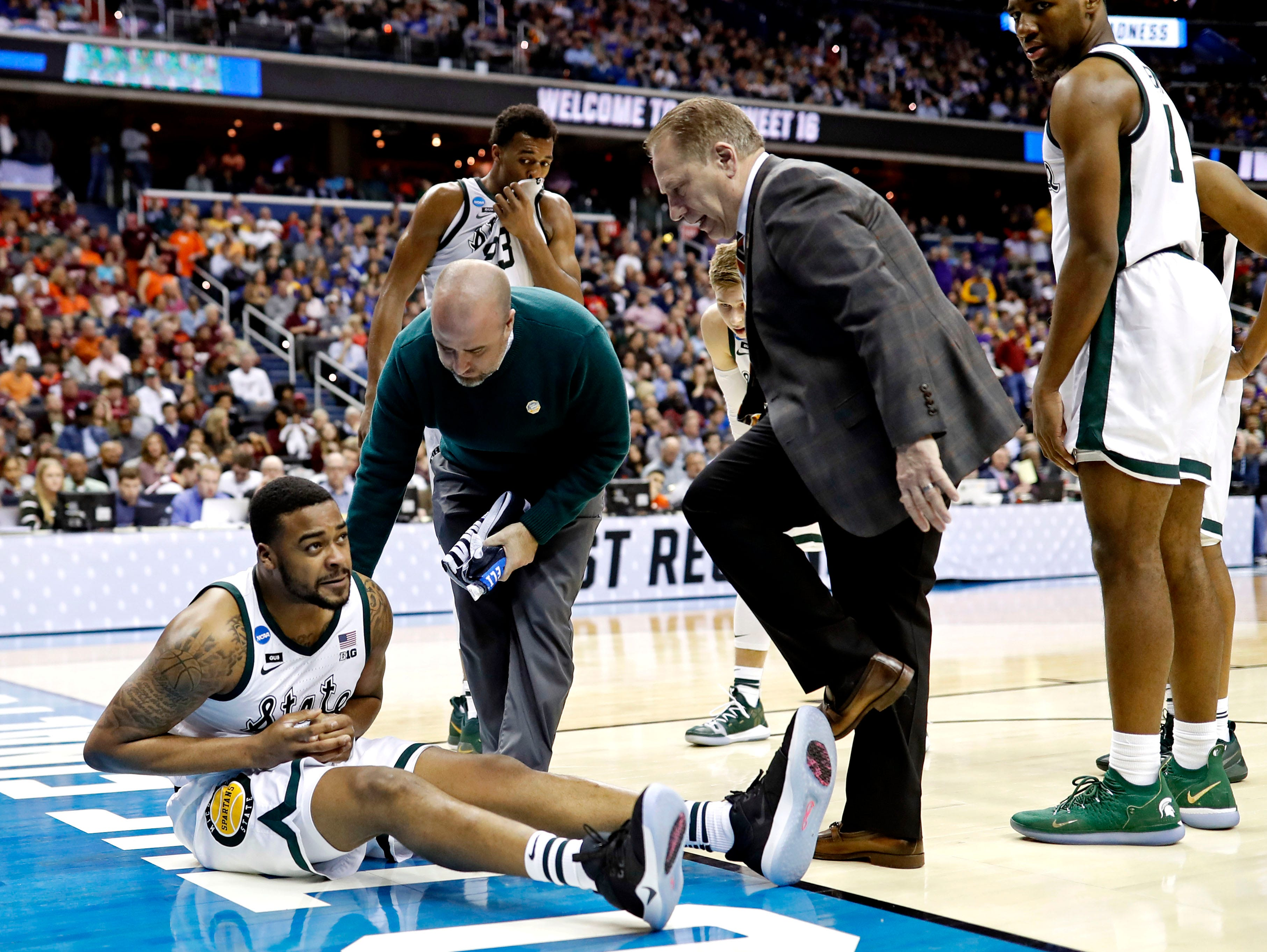 Michigan State Spartans forward Nick Ward (44) reacts after an injury during the second half against the LSU Tigers in the semifinals of the east regional of the 2019 NCAA Tournament at Capital One Arena.