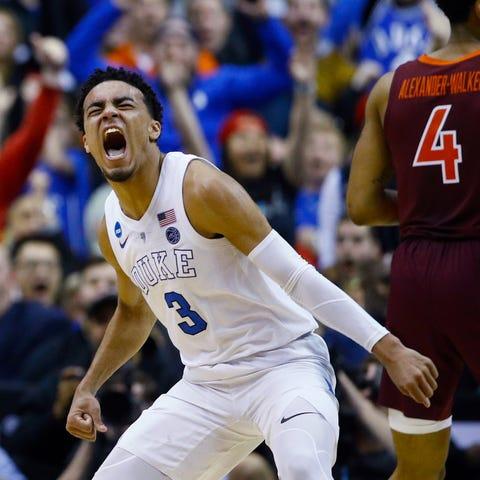 Duke guard Tre Jones reacts after scoring against...