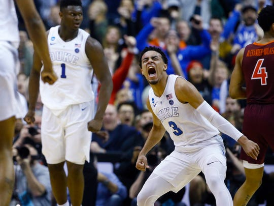 Duke guard Tre Jones reacts after scoring against Virginia Tech during the second half of an NCAA tournament East Region semifinal in Washington, Friday, March 29, 2019.