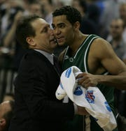 Michigan State's Chris Hill gets a hug from coach Tom Izzo after he came out of the game in the win over Kentucky in  the 2005 NCAA tournament regional  final on Sunday, March 27, 2005, in Austin, Texas.