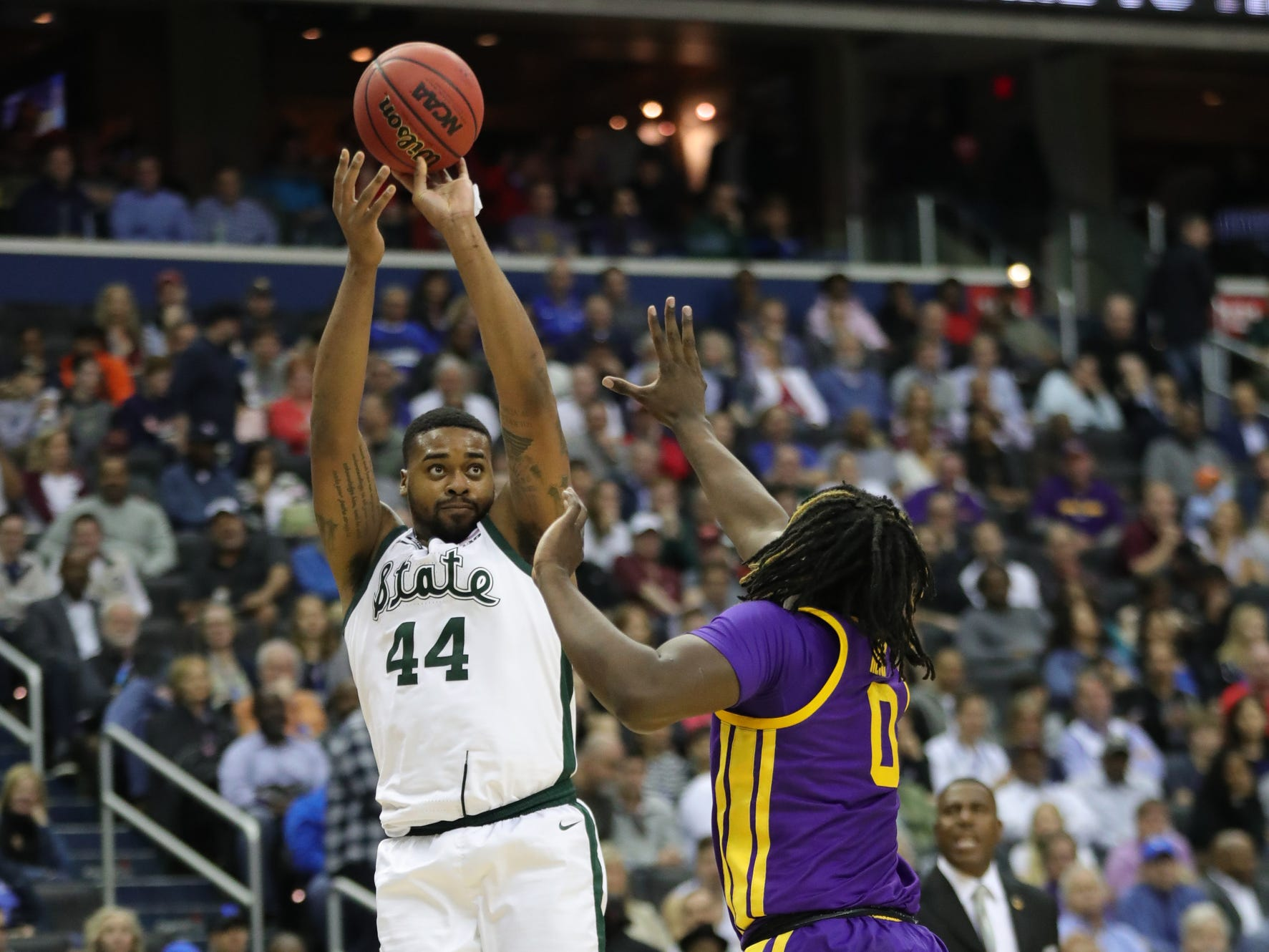 Michigan State forward Nick Ward scores against LSU forward Naz Reid during the first half of MSU's 80-63 win over LSU in the NCAA tournament on Friday, March 29, 2019, in Washington.