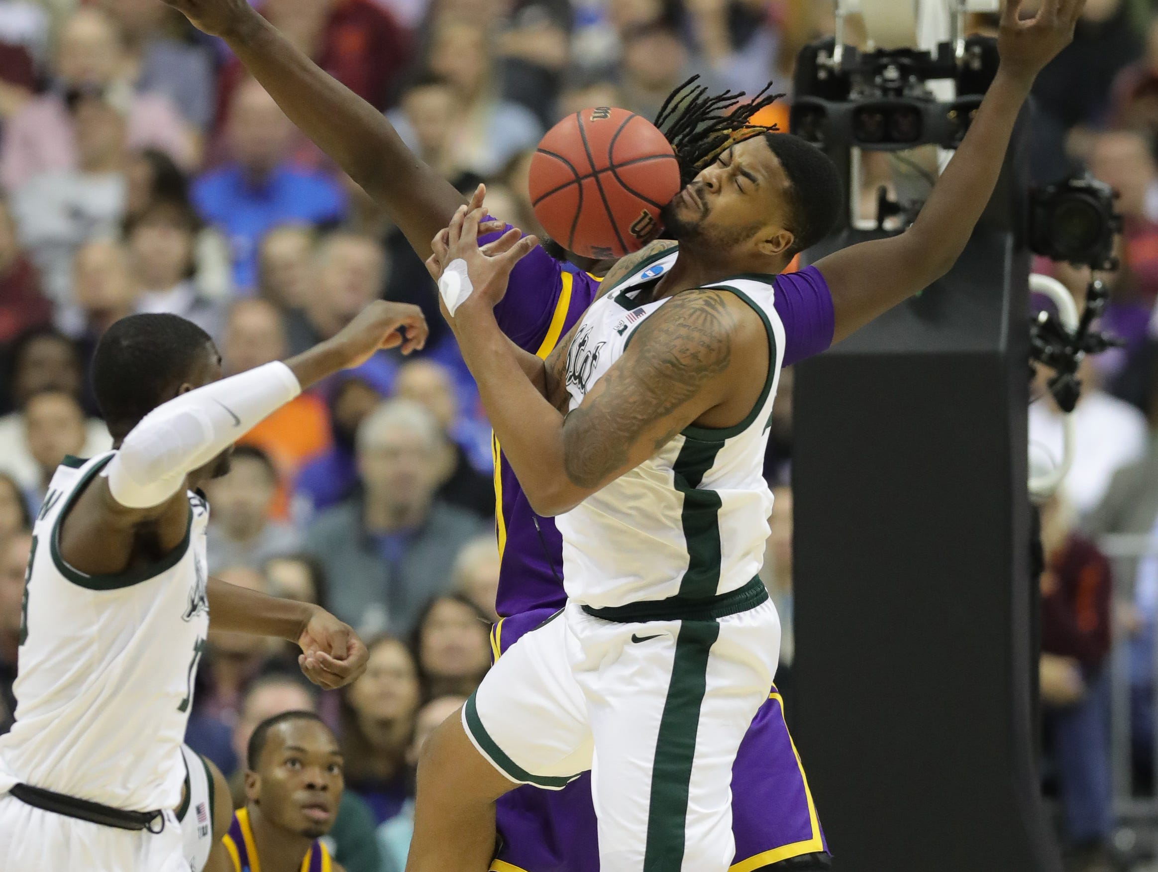 Michigan State forward Nick Ward defends against LSU forward Naz Reid during the second half of MSU's 80-63 win over LSU in the NCAA tournament on Friday, March 29, 2019, in Washington.