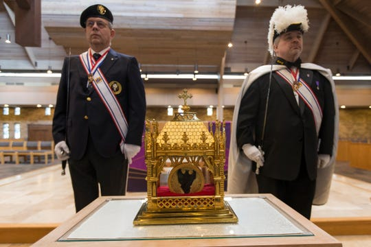 Physical heart of France's St. John Vianney in reliquary during Heart of a Priest tour at St. John Vianney Parish in Shelby Township, Saturday, March 30, 2019. Behind the reliquary are honor guards from Knights of Columbus John Carry, Divine Mercy Assembly's Faithful Captain and Mark Palmer, Bishop Gallagher Assembly's Faithful Navigator.