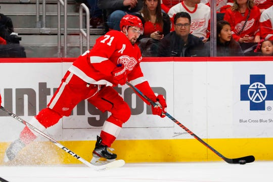Red Wings center Dylan Larkin skates with the puck in the second period on Friday, March 29, 2019, at Little Caesars Arena.