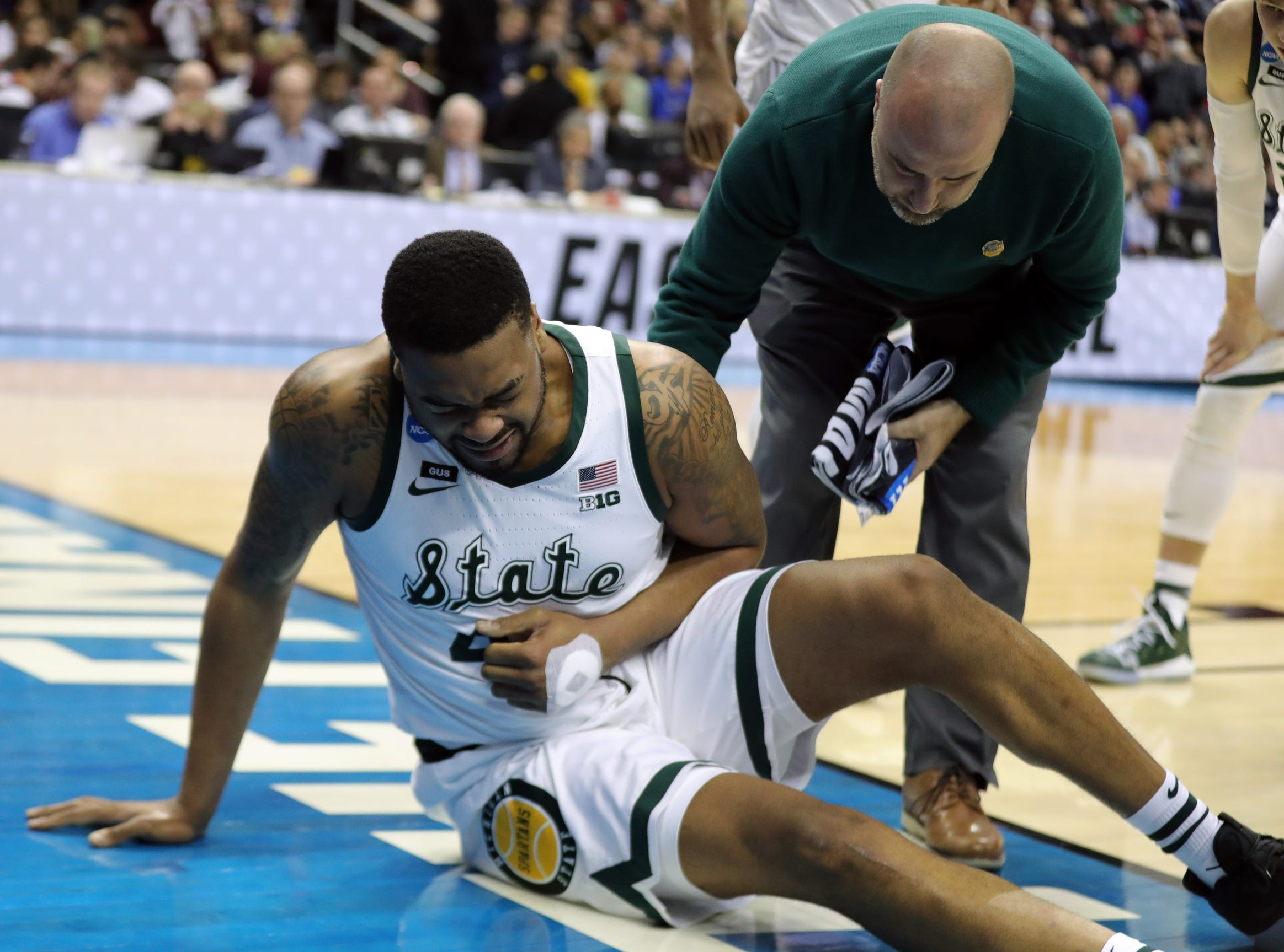 Michigan State forward Nick Ward goes down hurt during the second half of the 80-63 win over LSU in the NCAA tournament on Friday, March 29, 2019, in Washington.