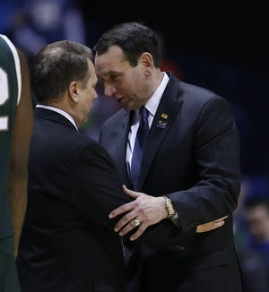 2013, Duke 71, MSU 61: Duke head coach Mike Krzyzewski, right, talks with Michigan State head coach Tom Izzo after Duke's 71-61 win in an NCAA tournament fourth-round game on March 29, 2013, in Indianapolis.