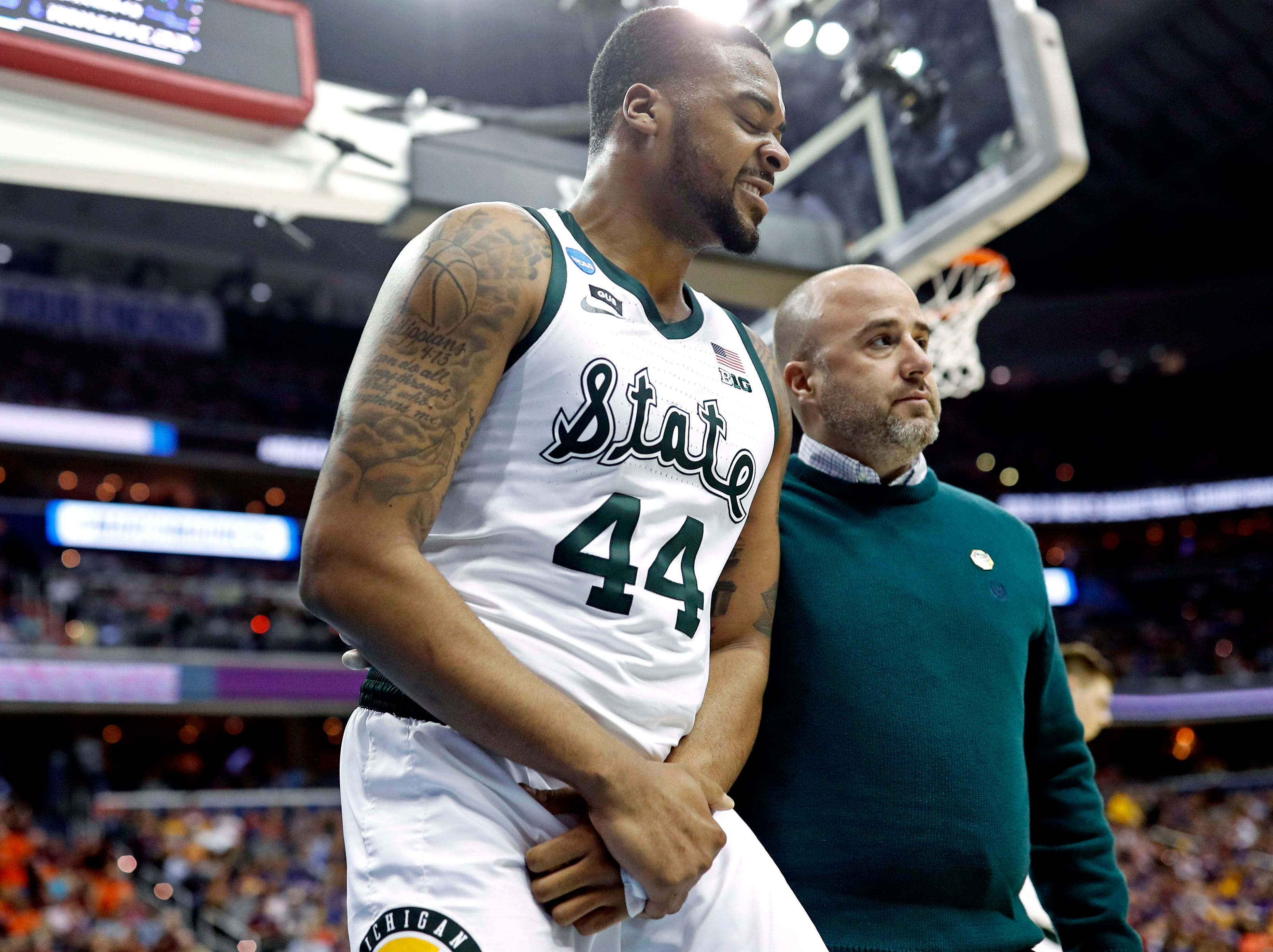 Michigan State Spartans forward Nick Ward (44) walks off the court after an injury during the second half against the LSU Tigers in the semifinals of the east regional of the 2019 NCAA Tournament at Capital One Arena.