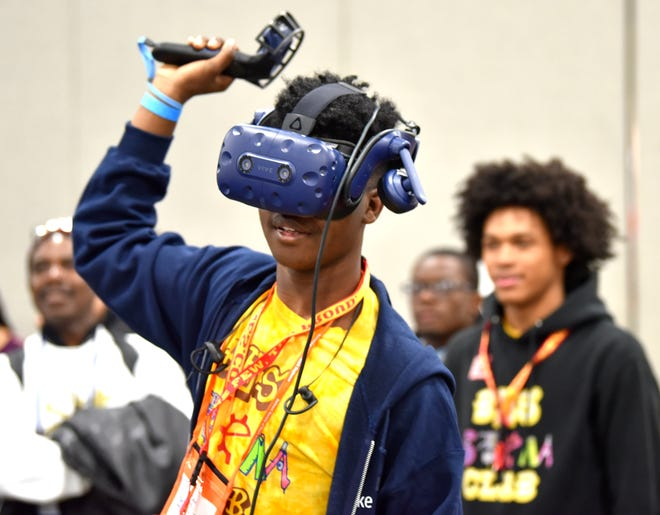Micah Newell wore a virtual reality headset like a crown Saturday as he learned of the endless career opportunitiesin STEAM fields.