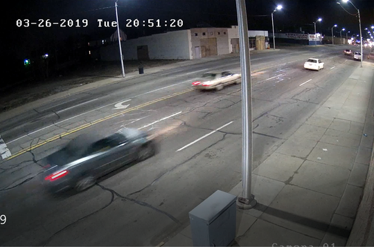 The dark-colored car was captured on surveillance footage around the time of the incident Tuesday night.
