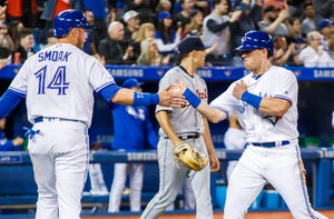 Toronto Blue Jays' Billy McKinney celebrates scoring with teammate Justin Smoak against the Detroit Tigers during the fourth inning.