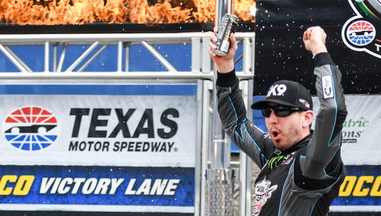 Driver Kyle Busch celebrates in Victory Lane on Saturday.