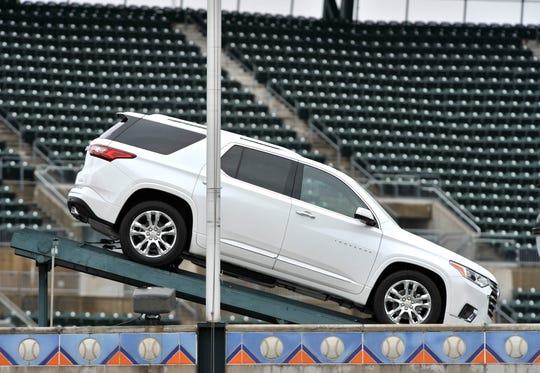 """""""We want people to enjoy baseball without distractions, so we have replaced the Chevrolet Blazer with a Chevrolet Traverse at theComerica Parkfountain,"""" GM spokesman Jim Cain said."""