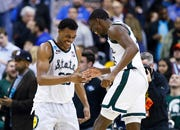 Michigan State forward Xavier Tillman, left, and teammate Gabe Brown, right, celebrate after the team's 80-63 win over LSU.