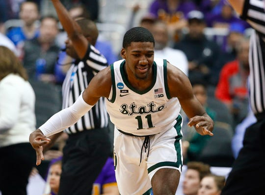 Michigan State forward Aaron Henry makes a 3-pointer against LSU.
