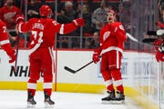 Detroit Red Wings defenseman Danny DeKeyser, right, celebrates his goal with Dylan Larkin (71) during the first period.