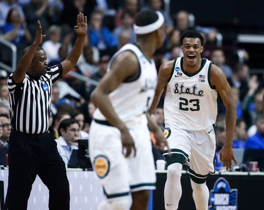 Michigan State forward Xavier Tillman (23) reacts to scoring against LSU during the first half.