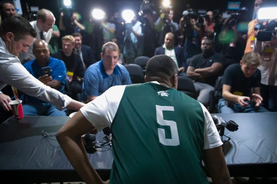 Michigan State guard Cassius Winston arrives at a press conference Saturday.