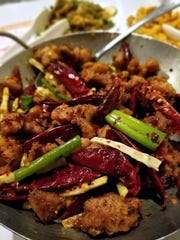Chicken with dried chile peppers, Szechwan peppercorns and scallions at the Szechwan Restaurant.