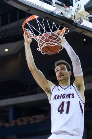 Bellarmine's Adam Eberhard (41), an Evansville native playing for the West team, dunks during the second half of the 2019 Reese's NABC Division II All-Star game at Ford Center in Evansville, Ind., Friday, March 29, 2019. Adam Eberhard finished with 16 points, six rebounds and two assists.