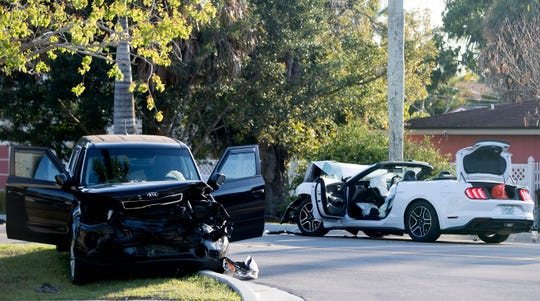 Fort Myers Police work the scene of a head-on crash on Saturday that has shut down McGregor Boulevard between Coconut Drive and Alcazar. Both drivers were taken to Lee Memorial Hospital. Information about their condition was not available.Ê
