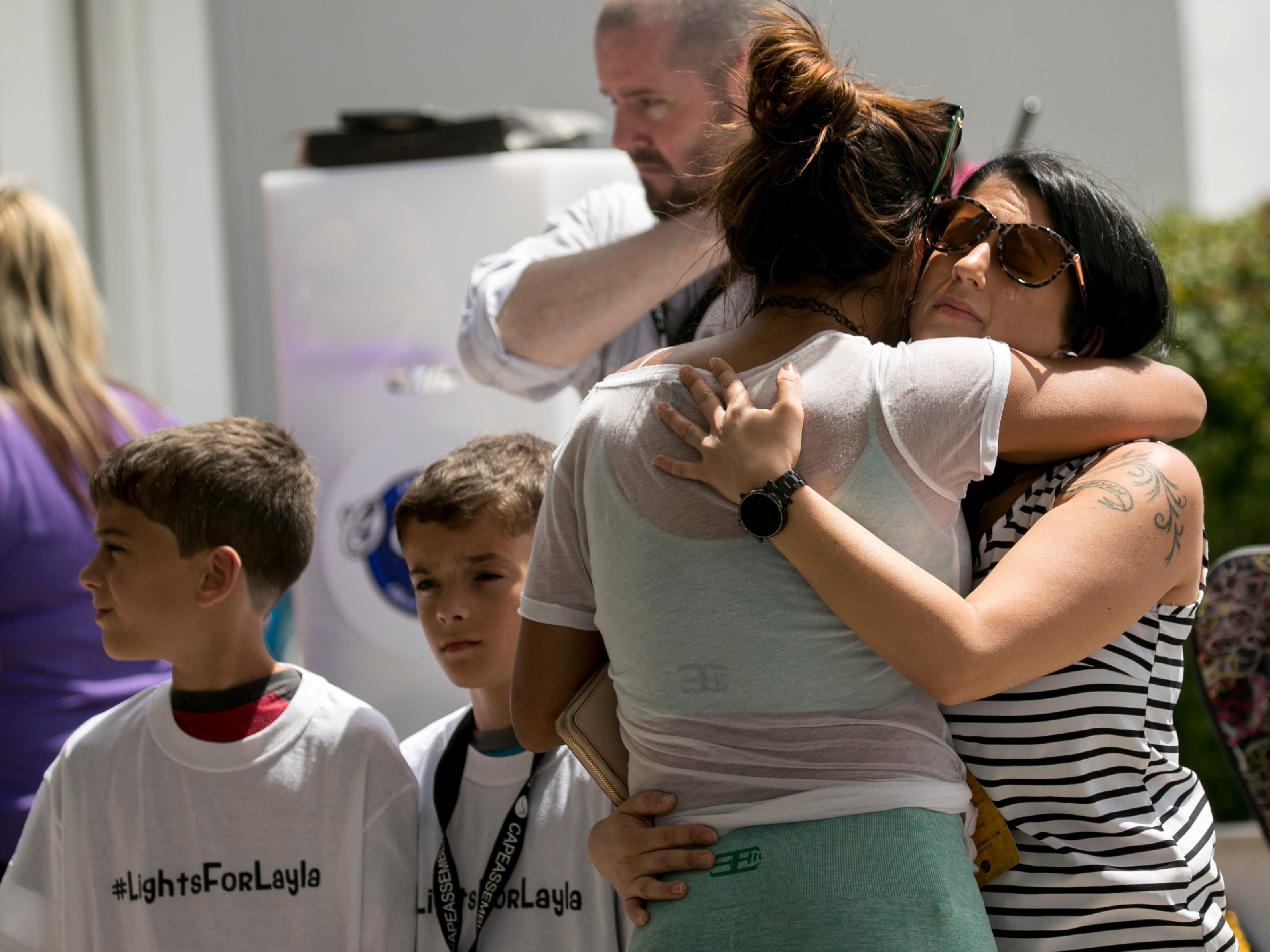 Lusana Diaz hugs Katleen Aiken, right, at the Lights for Layla fundraiser on Saturday, March 30, 2019, in Cape Coral. Aiken's daughter Layla was killed by a hit-and-run driver this week.