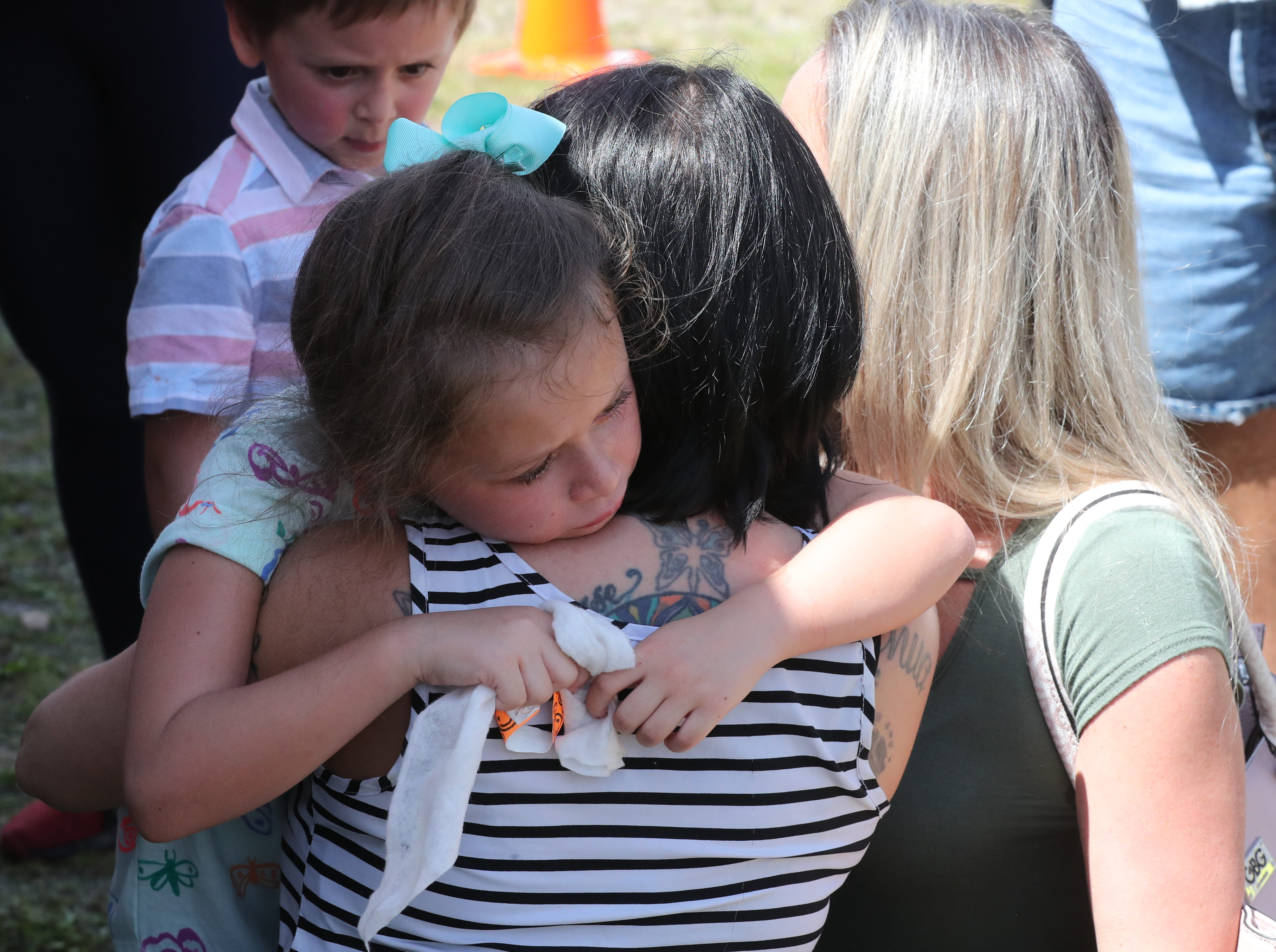Cheyanne Begle, 7 of Cape Coral and classmate of Layla, hugs Kathleen Aiken, Layla's mom at the event Saturday. Lights for Layla fundraiser. Lee County students who wait for school buses in the dark morning hours will be able to adorn their backpacks with flashing LED lights starting next year. Local agencies are partnering to raise money for the new safety protocols after the death of 8-year-old Layla Aiken, who was hit by a pickup truck while waiting at her bus stop with her brothers. Layla's family and friends hosted their own fundraiser called Lights for Layla Saturday from 1-3 p.m. at the Cape Assembly church, Cape Coral.