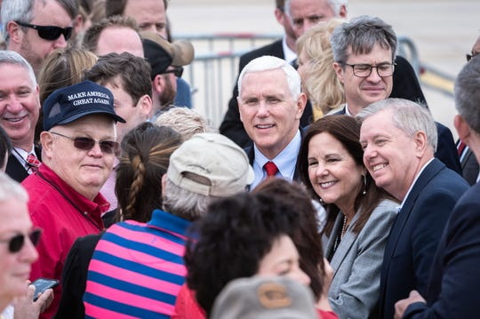 Sen. Lindsey Graham and Vice President Mike Pence work the rope line after landing at Greenville-Spartanburg airport in Greer, S.C with Gov. Henry McMaster and his wife Peggy McMaster for a rally kicking off the re-election campaign of Sen. Graham at the Marriott in Greenville, S.C Mar. 30, 2019.