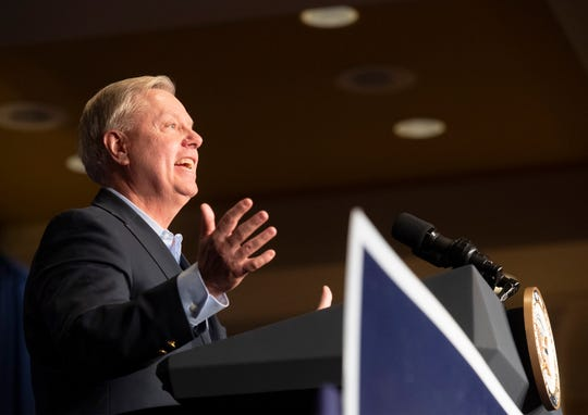 Sen. Lindsey Graham talks to a crowd gathered in the Greenville Marriott Saturday, Mar. 30, 2019 for his reelection kickoff reception.