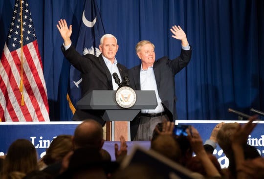 Vice President Mike Pence (left) and U.S. Sen. Lindsey Graham wave to the crowd gathered at the Greenville Marriott, Saturday, March 30, 2019 after speaking at Graham's Upstate Kickoff Reception for his 2020 re-election campaign.