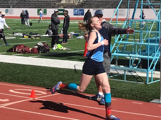 Great Falls High freshman Emily Shores crosses the finish line in third place in the girls' 800 meters during the Bison/Helena/West triangular meet at Memorial Stadium.