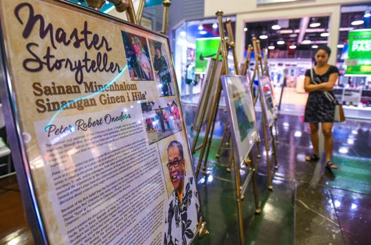 Posters featuring information on CHamoru cultural masters are displayed during a Guam Council of the Arts and Humanities Agency outreach at the Guam Premier Outlets in Tamuning on Saturday, March 30, 2019. The event was held in observance of the Mes CHamoru, or Chamorro Month, celebration. The agency plans to host a similar event again on Sunday, March 31, at the Agana Shopping Center, featuring more artisans and cultural performances, said Jackie Balbas, CAHA program coordinator.