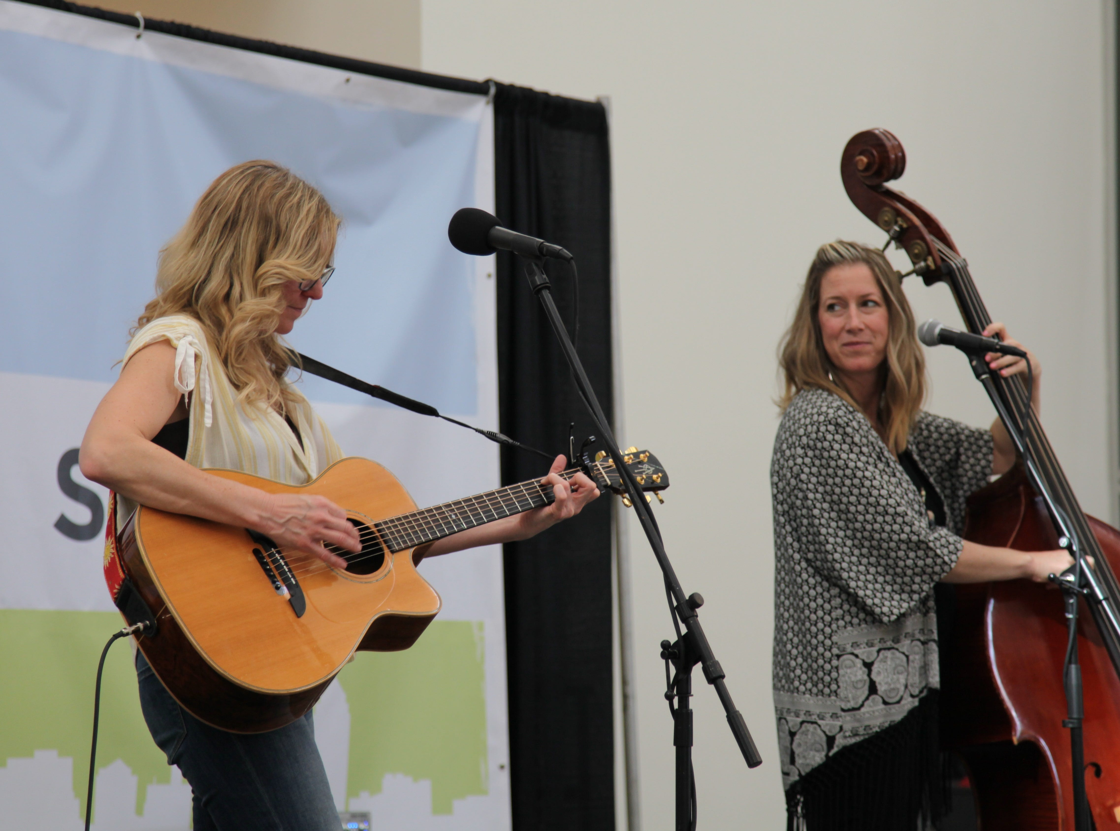 Musicians perform at the DSM Book Festival downtown on Saturday, March 30, 2019.