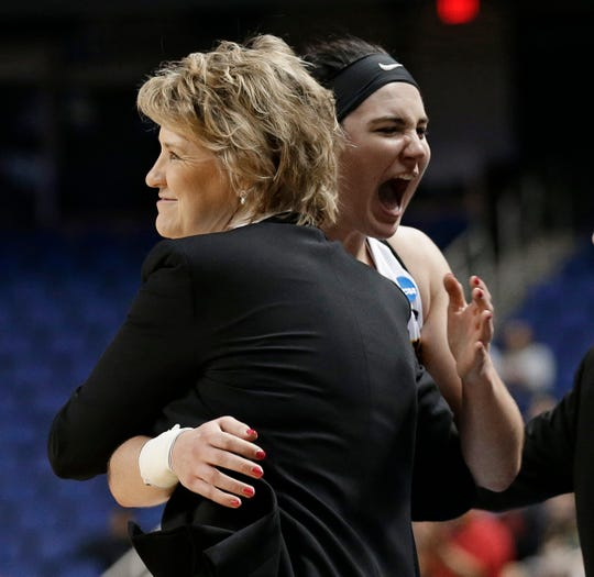 Iowa head coach Lisa Bluder, left, hugs Megan Gustafson, right, during the second half of a regional women's college basketball game against North Carolina State in the NCAA Tournament in Greensboro, N.C., Saturday, March 30, 2019. (AP Photo/Gerry Broome)