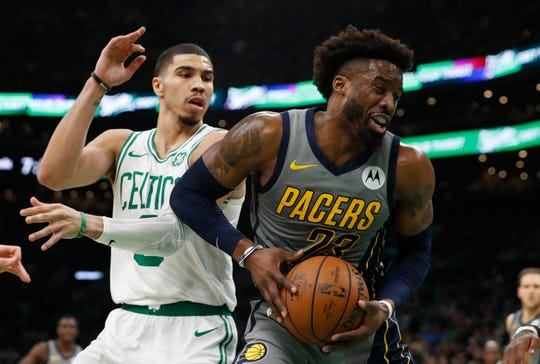 Mar 29, 2019; Boston, MA, USA; Indiana Pacers guard Wesley Matthews (23) grabs the rebound against Boston Celtics forward Jayson Tatum (0) in the second quarter at TD Garden. Mandatory Credit: David Butler II-USA TODAY Sports