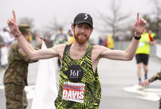 Jesse Davis of Indianapolis crossed the finish line in a time of 2.23:14 to win the 9th annual Carmel Marathon, Saturday, March 30, 2019.