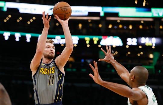 Pacers forward Domantas Sabonis (11) shot against Boston Celtics center Al Horford (42) in a playoff game at TD Garden. Mandatory Credit: David Butler II-USA TODAY Sports