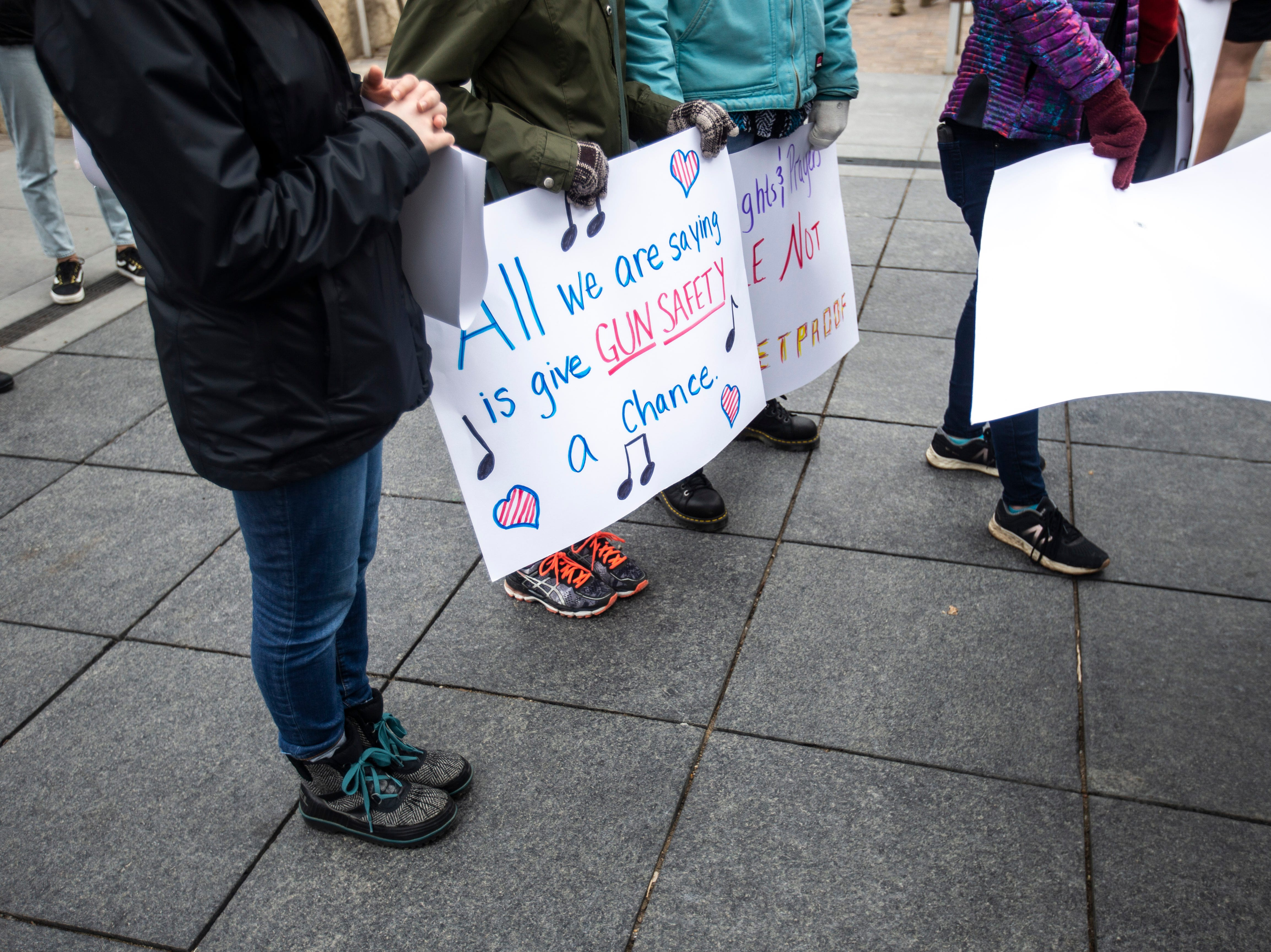 Community members gather during an event organized by the Students Against School Shootings group on Saturday, March 30, 2019, along the pedestrian mall in downtown Iowa City, Iowa.
