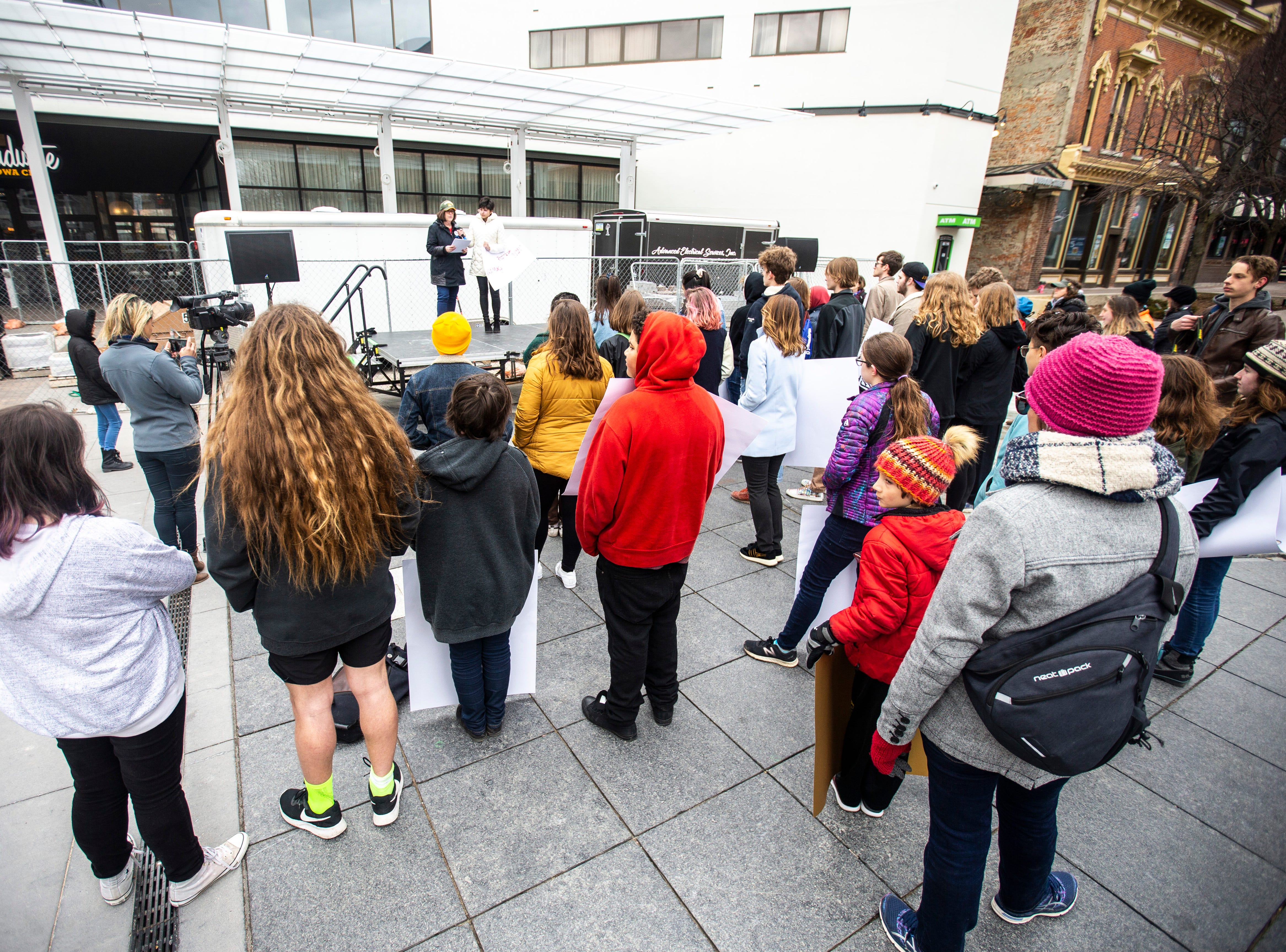 Holly Sanger, of the Moms Demand Action group speaks during an event organized by the Students Against School Shootings group on Saturday, March 30, 2019, along the pedestrian mall in downtown Iowa City, Iowa.