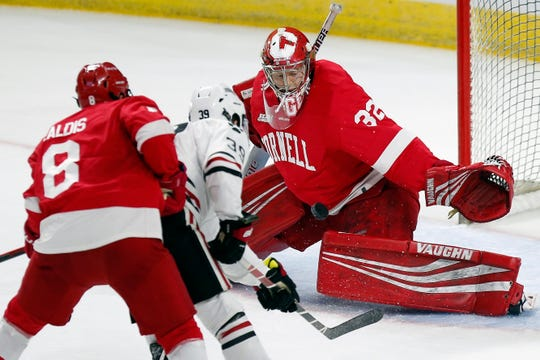 Cornell's Austin McGrath (32) blocks a shot by Northeastern's Liam Pecararo (39) during the first period of an NCAA Division I East Regional semifinal men's hockey game in Providence, R.I., Saturday, March 30, 2019. (AP Photo/Michael Dwyer)