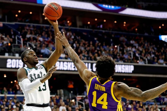 Mar 29, 2019; Washington, DC, USA; Michigan State Spartans forward Gabe Brown (13) shoots the ball against LSU Tigers guard Marlon Taylor (14) during the second half in the semifinals of the east regional of the 2019 NCAA Tournament at Capital One Arena. Mandatory Credit: Geoff Burke-USA TODAY Sports