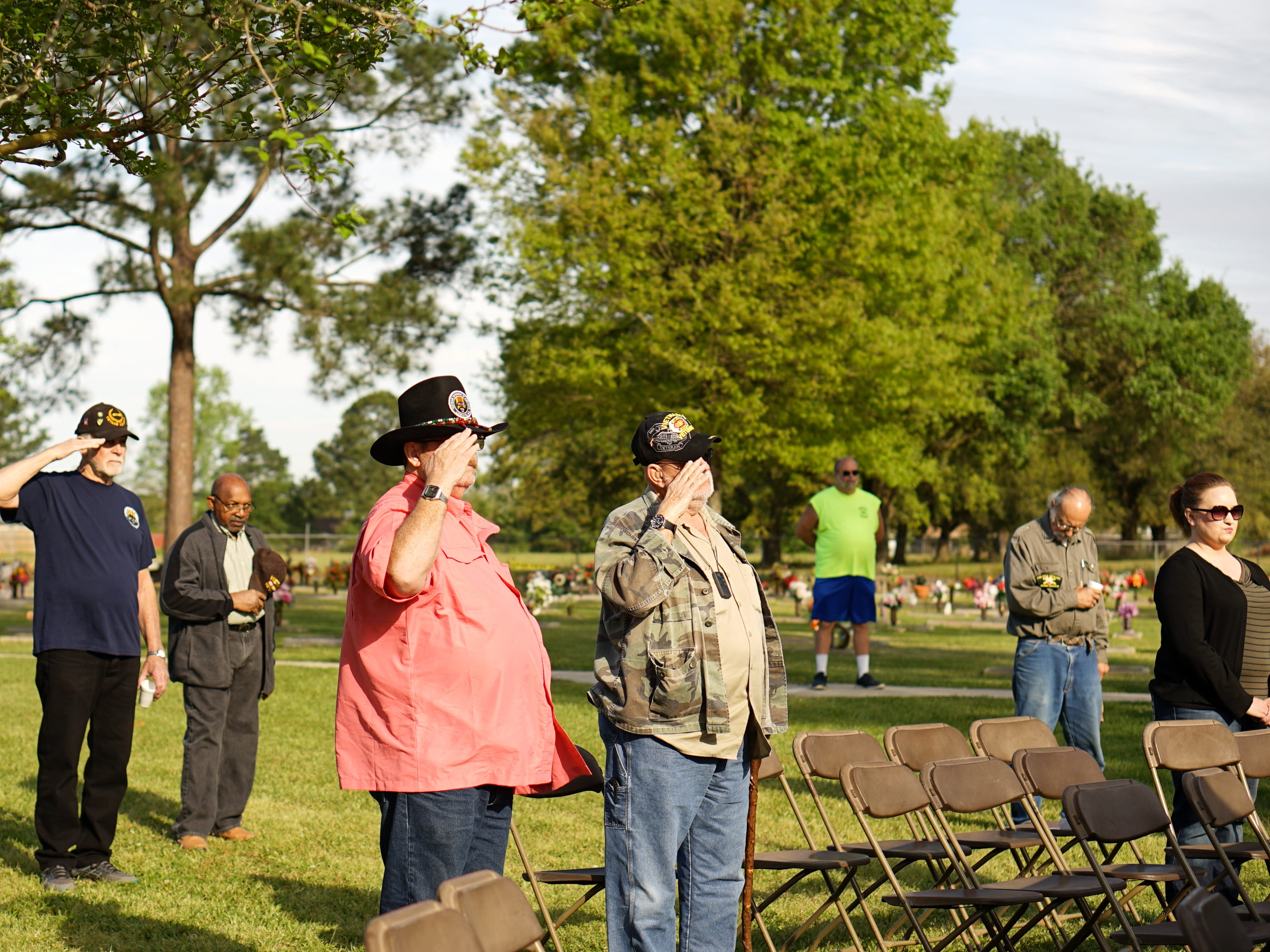 """Onlookers and veterans salute during the """"Welcome Home Vietnam Veterans"""" event at Fountain Memorial Funeral Home and Cemetery in Lafayette on Friday, March 29, 2019."""