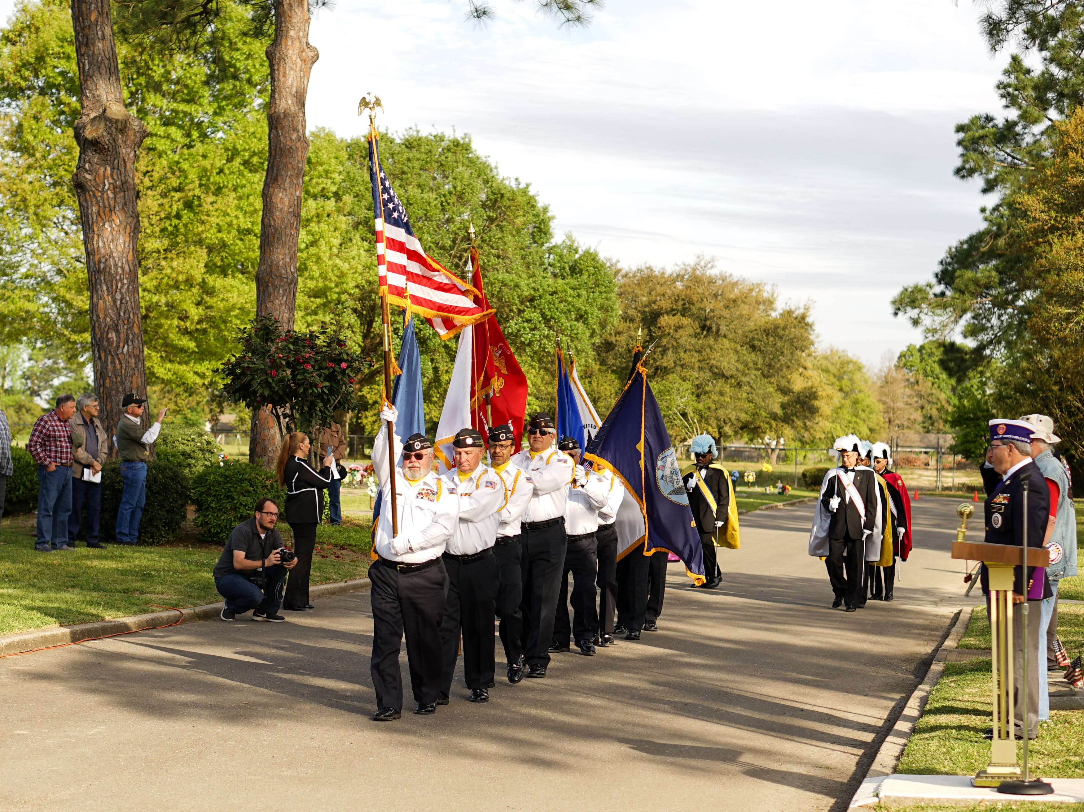 """Members of the Acadiana Veterans Honor Guard and the Knights of Columbus process with the American flag and the flags of the U.S. Armed Forces during the """"Welcome Home Vietnam Veterans"""" event at Fountain Memorial Funeral Home and Cemetery in Lafayette on Friday, March 29, 2019. The event honoring those who served in the Vietnam War also featured two speakers and a wreath-laying ceremony."""