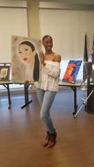 St. Martinville senior Jordan Landry shows off some of her artwork.