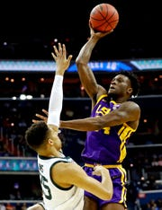 Mar 29, 2019; Washington, DC, USA; LSU Tigers guard Marlon Taylor (14) shoots the ball against Michigan State Spartans forward Kenny Goins (25) during the first half in the semifinals of the east regional of the 2019 NCAA Tournament at Capital One Arena. Mandatory Credit: Geoff Burke-USA TODAY Sports