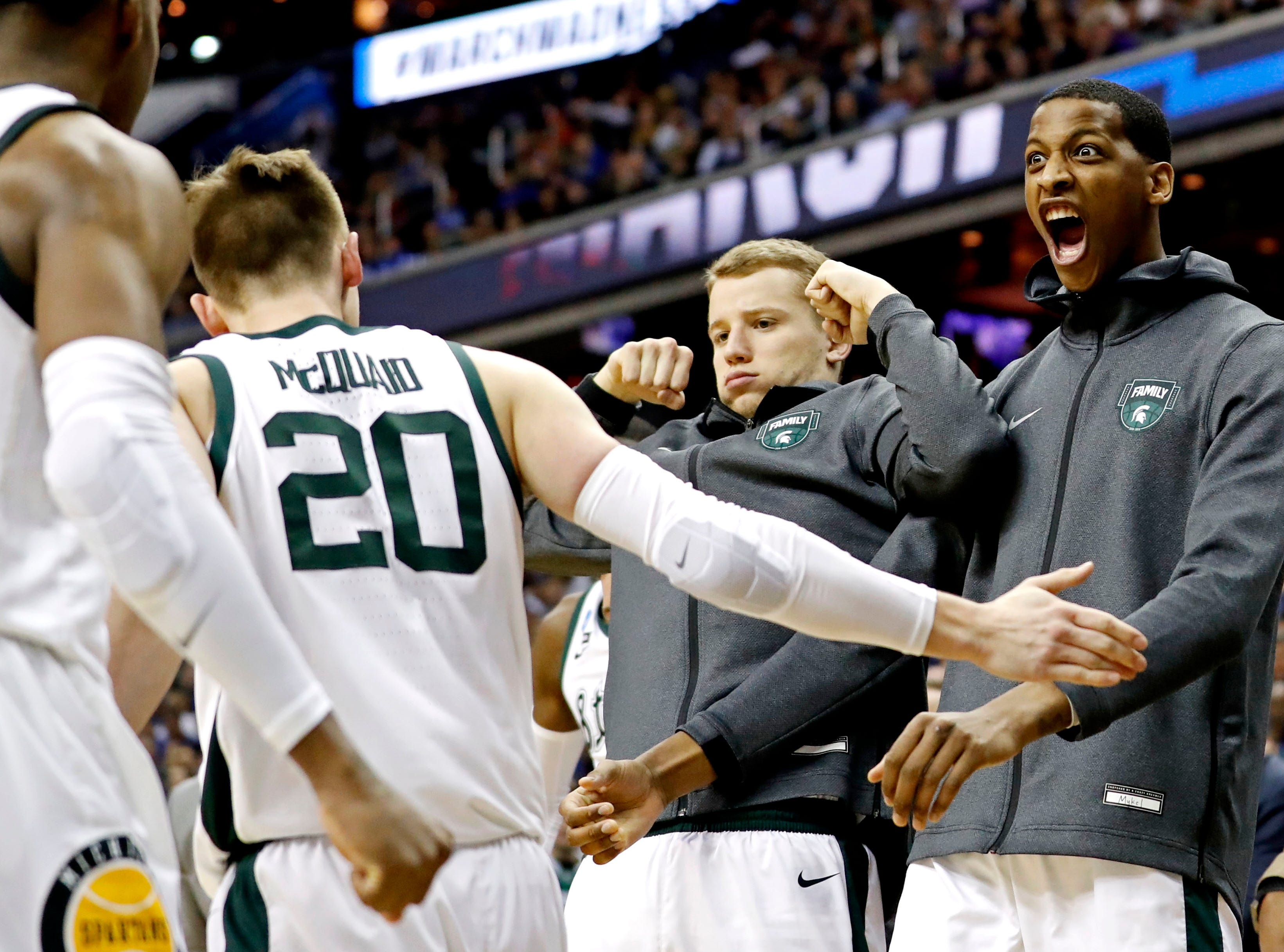 Mar 29, 2019; Washington, DC, USA; The Michigan State Spartans reacts with guard Matt McQuaid (20) during the second half against the LSU Tigers in the semifinals of the east regional of the 2019 NCAA Tournament at Capital One Arena. Mandatory Credit: Geoff Burke-USA TODAY Sports